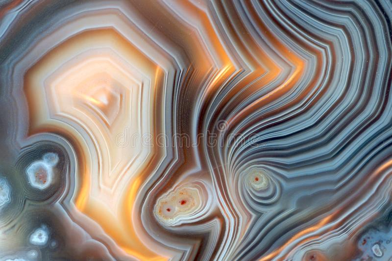 Banded Agate pattern with several layers. Closeup of a banded Agate specimen. The layered structure is formed when a rock cavity or geode is filled with royalty free stock photography