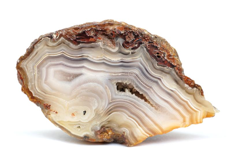 Banded Agate specimen. The layered structure is formed when a rock cavity or geode is filled with siliceous matter, layer by layer stock photos