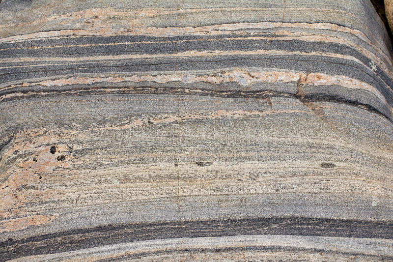 Banded gneiss rock royalty free stock photos