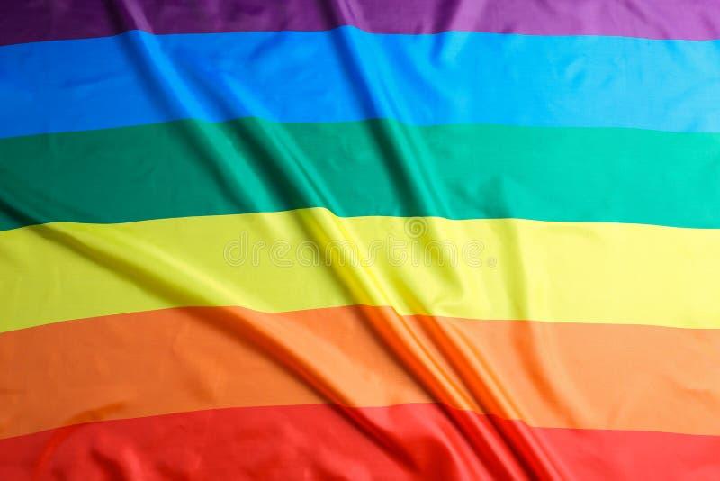 Bandeira alegre do arco-íris brilhante como o fundo fotos de stock royalty free