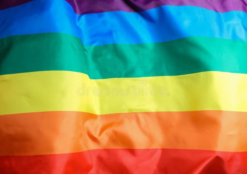 Bandeira alegre do arco-íris brilhante como o fundo imagens de stock royalty free