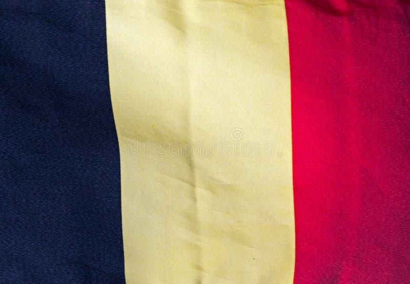 Bandeira belga no vento contra um céu imagem de stock