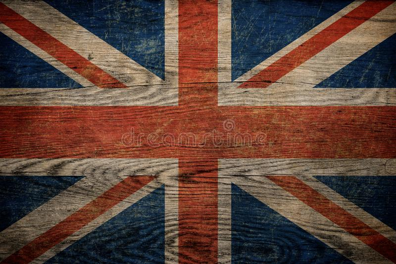 Bandeira britânica do Grunge no fundo de madeira imagem de stock royalty free