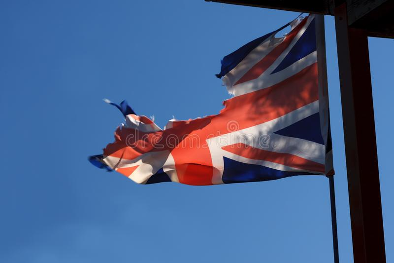 Bandeira britânica rasgada fotos de stock