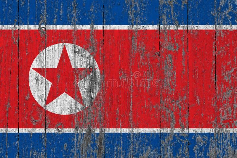 Bandeira da Coreia do Norte pintada para fora em fundo de madeira gasto da textura foto de stock royalty free