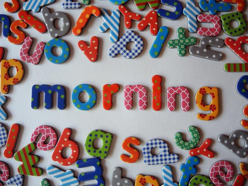 Bandeira da manhã com letras coloridas fotografia de stock