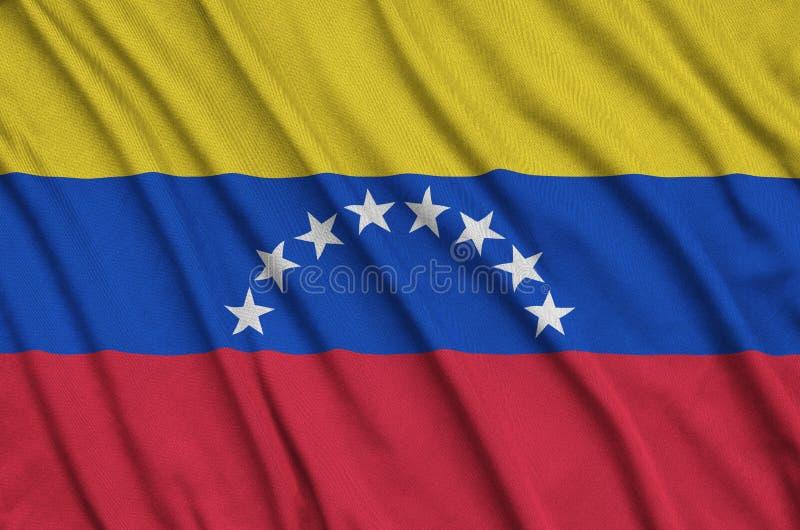 A bandeira da Venezuela é descrita em uma tela de pano dos esportes com muitas dobras Bandeira da equipe de esporte fotos de stock royalty free
