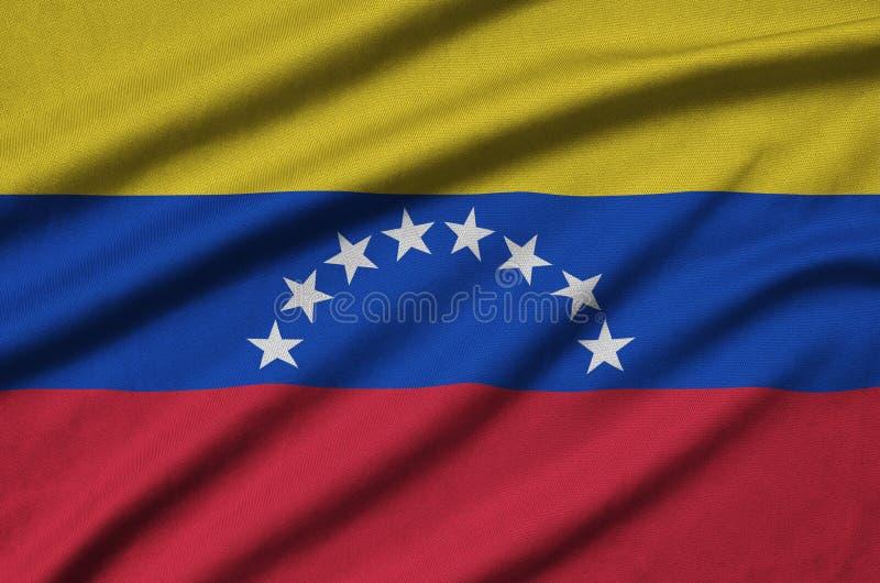 A bandeira da Venezuela é descrita em uma tela de pano dos esportes com muitas dobras Bandeira da equipe de esporte imagem de stock royalty free