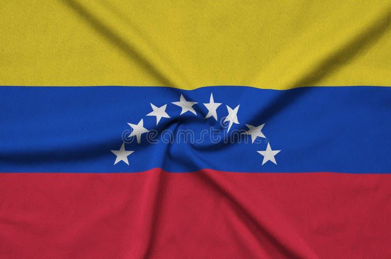 A bandeira da Venezuela é descrita em uma tela de pano dos esportes com muitas dobras Bandeira da equipe de esporte fotos de stock