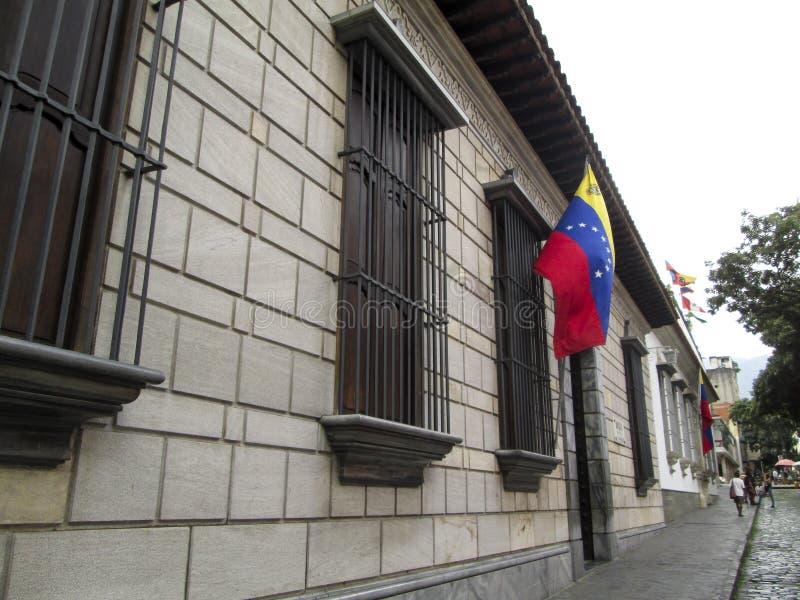 Bandeira da Venezuela e da Venezuela de Caracas do lugar de nascimento da casa de Simon Bolivar fotografia de stock