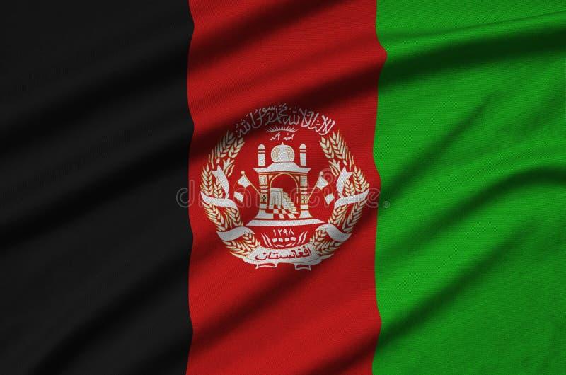 A bandeira de Afeganistão é descrita em uma tela de pano dos esportes com muitas dobras Bandeira da equipe de esporte fotografia de stock royalty free