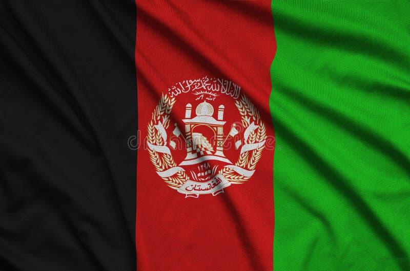 A bandeira de Afeganistão é descrita em uma tela de pano dos esportes com muitas dobras Bandeira da equipe de esporte fotos de stock