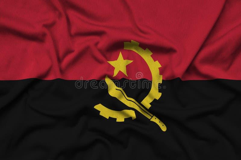 A bandeira de Angola é descrita em uma tela de pano dos esportes com muitas dobras Bandeira da equipe de esporte fotos de stock royalty free