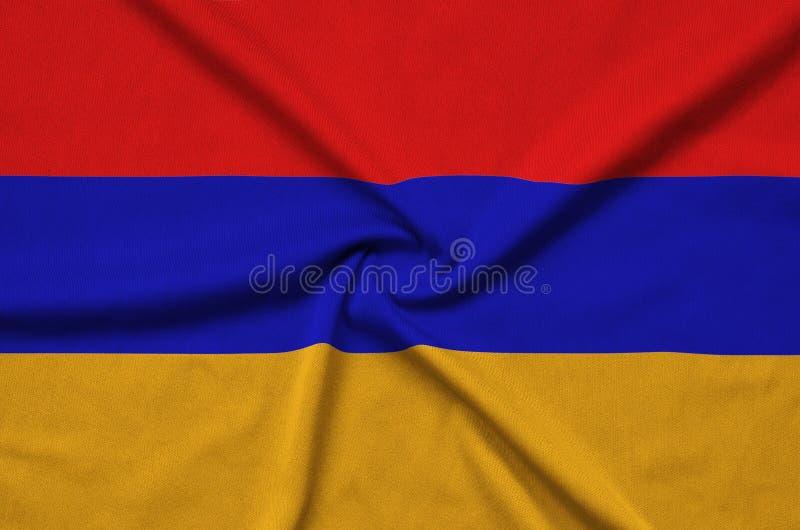 A bandeira de Armênia é descrita em uma tela de pano dos esportes com muitas dobras Bandeira da equipe de esporte fotos de stock