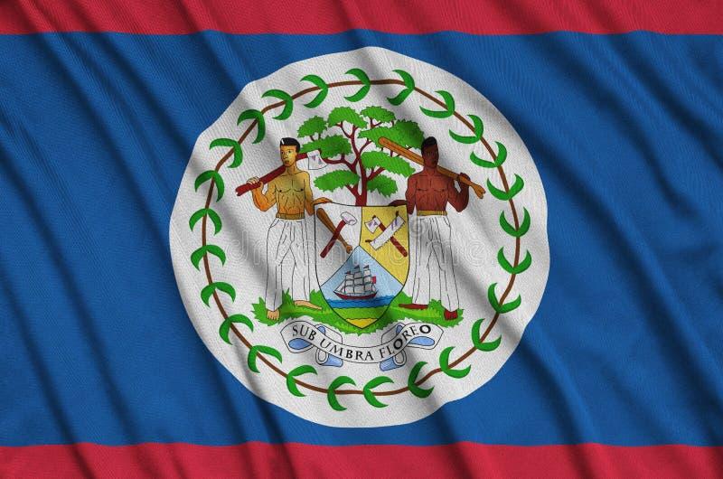 A bandeira de Belize é descrita em uma tela de pano dos esportes com muitas dobras Bandeira da equipe de esporte fotos de stock royalty free