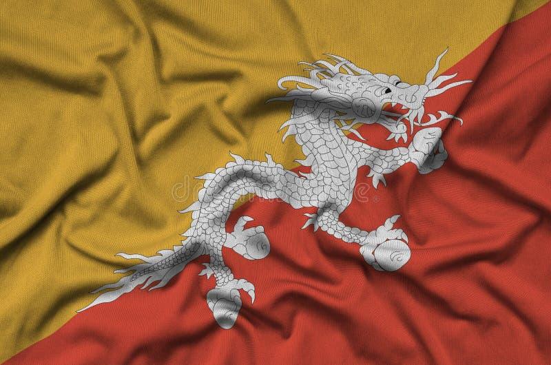 A bandeira de Butão é descrita em uma tela de pano dos esportes com muitas dobras Bandeira da equipe de esporte fotos de stock