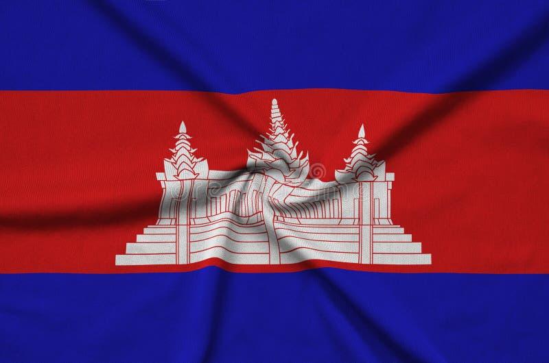 A bandeira de Camboja é descrita em uma tela de pano dos esportes com muitas dobras Bandeira da equipe de esporte foto de stock
