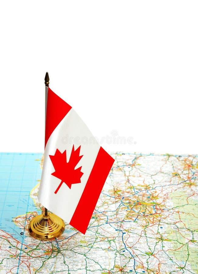 Bandeira de Canadá no mapa foto de stock royalty free