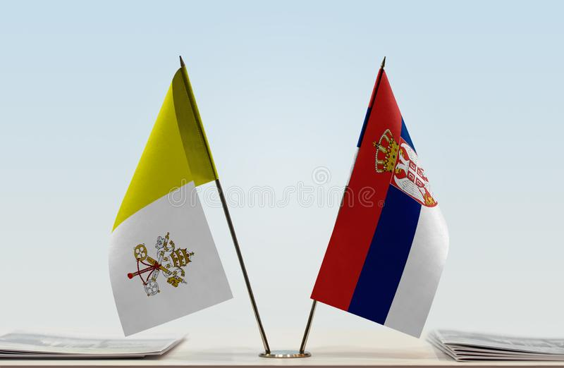Bandeira de Cidade Estado do Vaticano e da Sérvia fotos de stock
