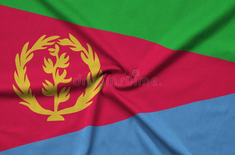 A bandeira de Eritreia é descrita em uma tela de pano dos esportes com muitas dobras Bandeira da equipe de esporte fotos de stock