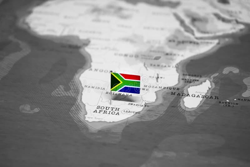 A bandeira de ?frica do Sul no mapa do mundo foto de stock royalty free