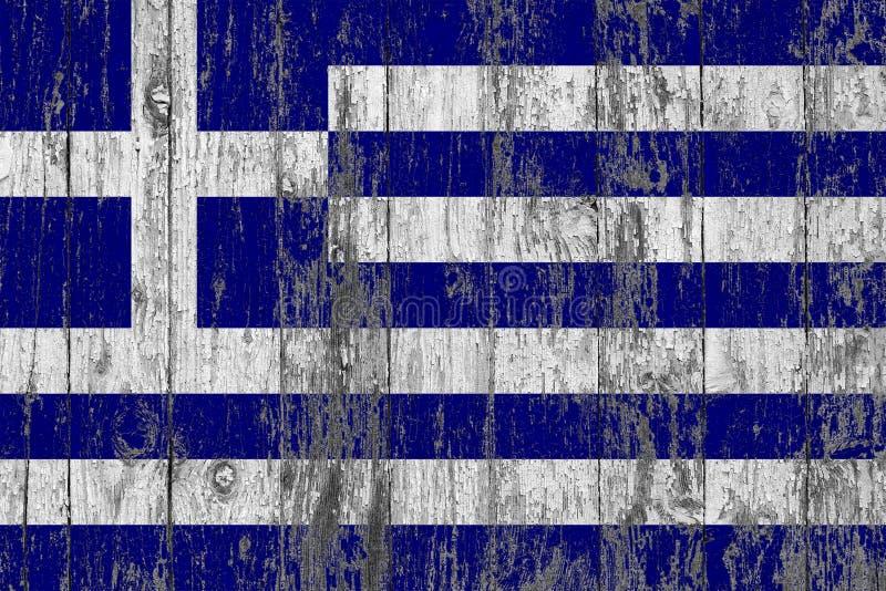 A bandeira de Grécia pintou para fora em fundo de madeira gasto da textura foto de stock royalty free