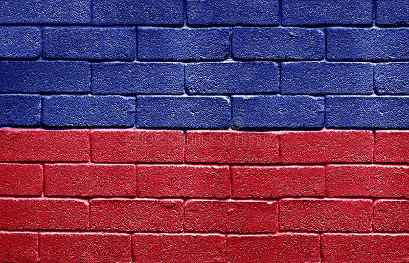 Bandeira de Haiti na parede de tijolo foto de stock royalty free