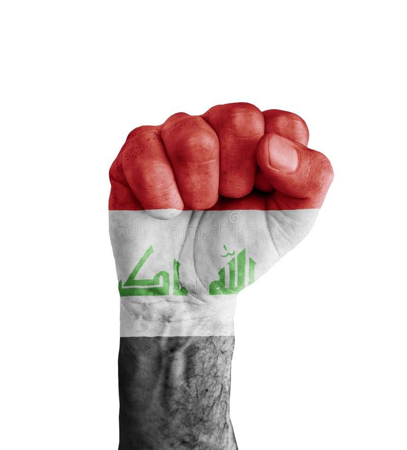 A bandeira de Iraque pintou no punho humano como o símbolo da vitória imagem de stock royalty free