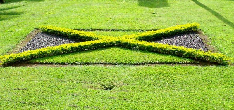 Bandeira de Jamaica no arbusto imagem de stock