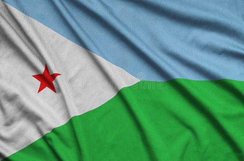 A bandeira de Jibuti é descrita em uma tela de pano dos esportes com muitas dobras Bandeira da equipe de esporte fotografia de stock