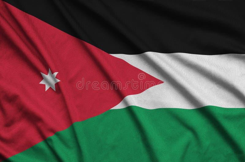 A bandeira de Jordânia é descrita em uma tela de pano dos esportes com muitas dobras Bandeira da equipe de esporte fotos de stock royalty free