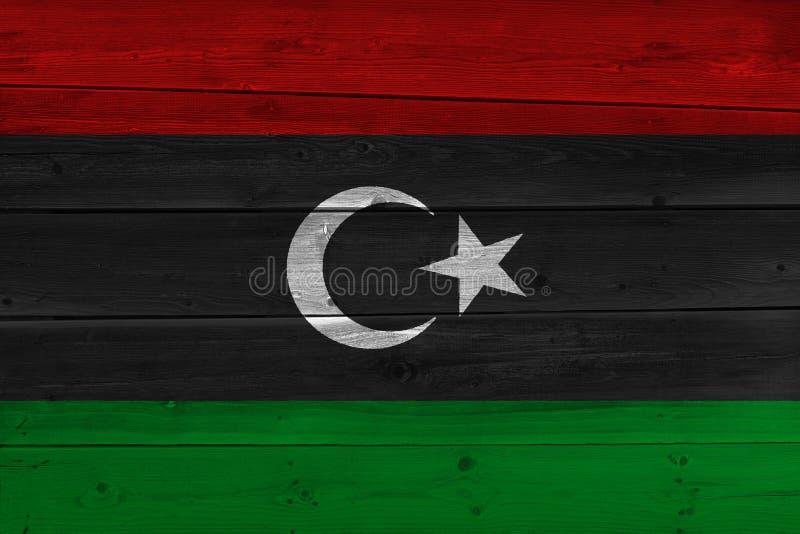 Bandeira de Líbia pintada na prancha de madeira velha imagem de stock royalty free