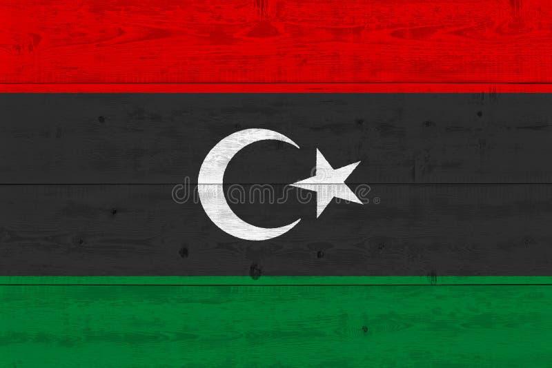 Bandeira de Líbia pintada na prancha de madeira velha imagens de stock
