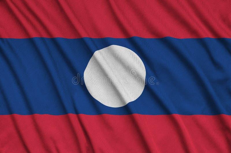A bandeira de Laos é descrita em uma tela de pano dos esportes com muitas dobras Bandeira da equipe de esporte imagem de stock royalty free