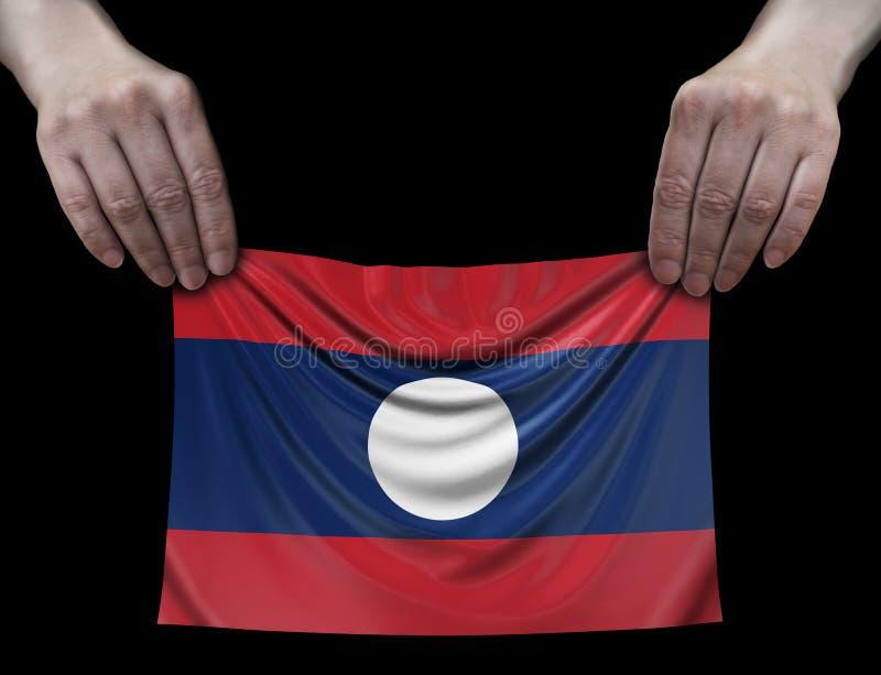 Bandeira de Laos nas mãos imagem de stock