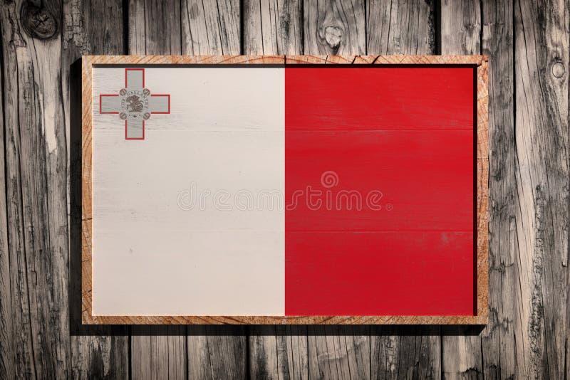 Bandeira de madeira de Malta foto de stock