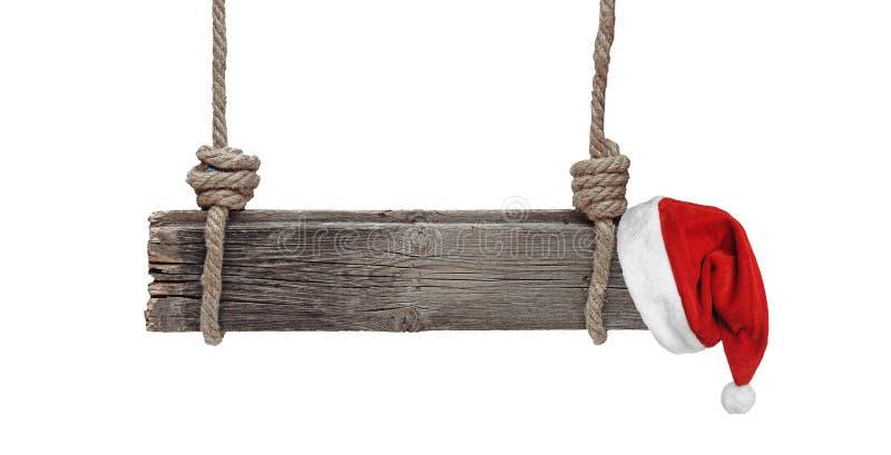 Bandeira de madeira velha com o chapéu de Santa isolado no fundo branco foto de stock royalty free