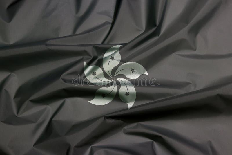 Bandeira de malha de Hong Kong a preto e branco O creme da bandeira de Hong-Kong é o conceito de 'Mourning' imagens de stock