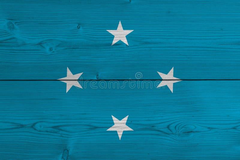 Bandeira de Micronésia pintada na prancha de madeira velha ilustração royalty free