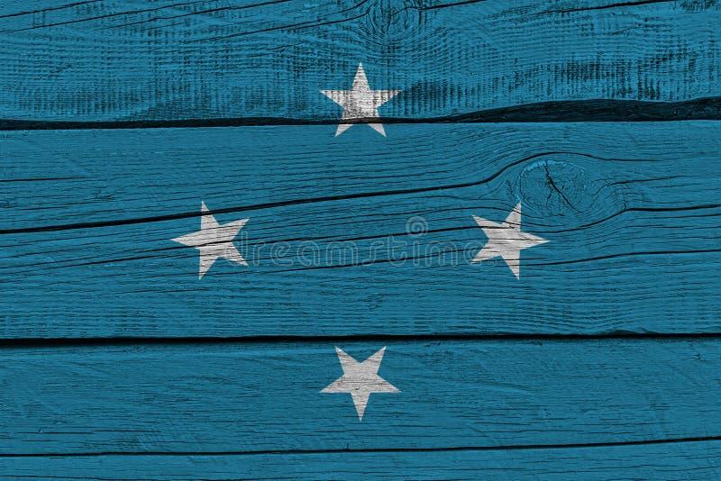 Bandeira de Micron?sia pintada na prancha de madeira velha ilustração stock