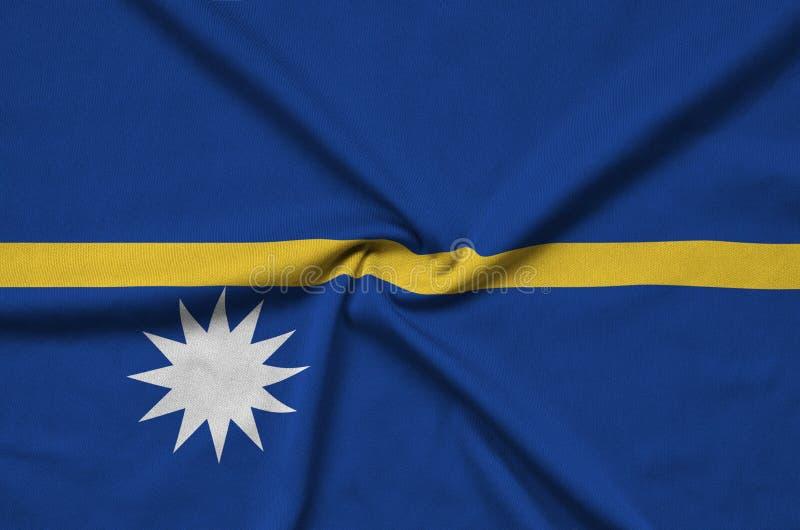 A bandeira de Nauru é descrita em uma tela de pano dos esportes com muitas dobras Bandeira da equipe de esporte foto de stock royalty free