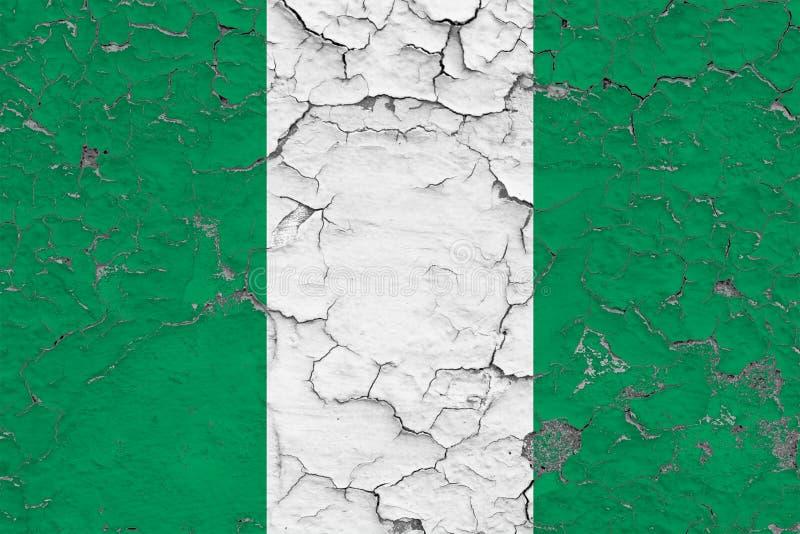 A bandeira de Nigéria pintou em parede suja rachada Teste padr?o nacional na superf?cie do estilo do vintage ilustração stock