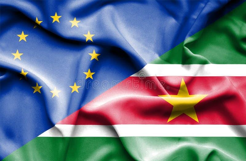 Bandeira de ondulação do Suriname e da UE foto de stock