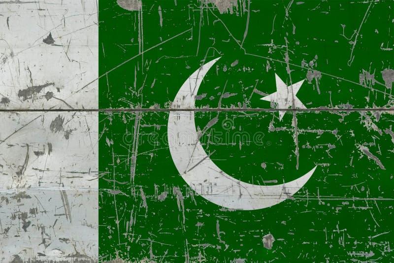 Bandeira de Paquistão do Grunge na superfície de madeira riscada velha Fundo nacional do vintage fotografia de stock royalty free