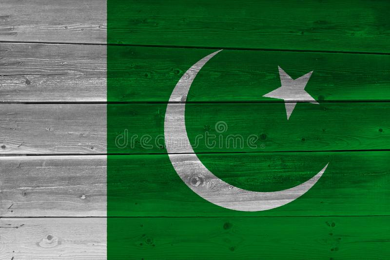 Bandeira de Paquistão pintada na prancha de madeira velha imagem de stock
