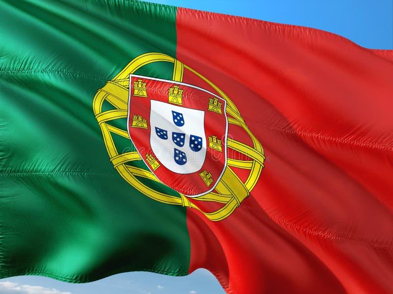 Bandeira de Portugal que acena no vento contra o c?u azul profundo Tela de alta qualidade imagem de stock royalty free