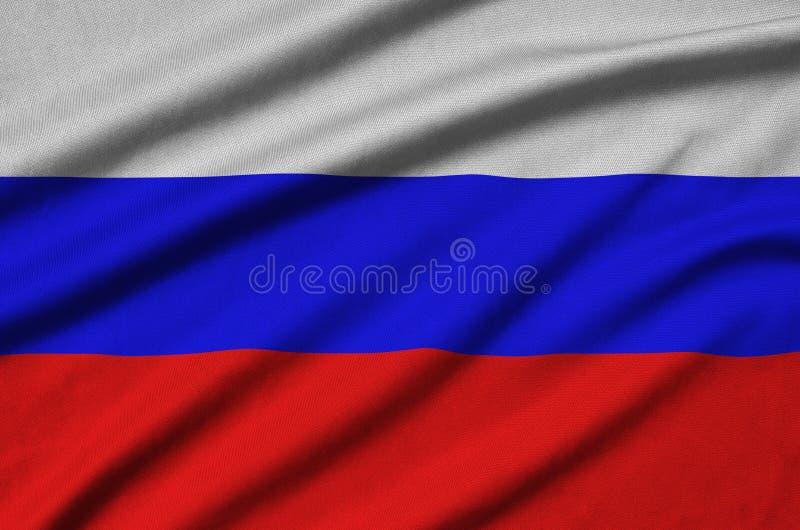 A bandeira de Rússia é descrita em uma tela de pano dos esportes com muitas dobras Bandeira da equipe de esporte imagens de stock royalty free