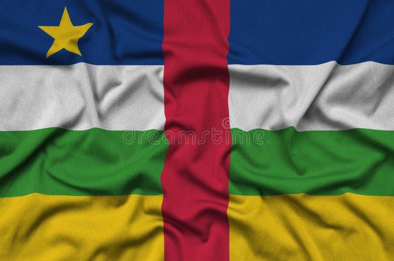 A bandeira de República Centro-Africana é descrita em uma tela de pano dos esportes com muitas dobras Bandeira da equipe de espor fotografia de stock royalty free