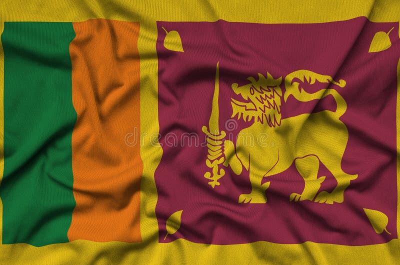 A bandeira de Sri Lanka é descrita em uma tela de pano dos esportes com muitas dobras Bandeira da equipe de esporte fotos de stock