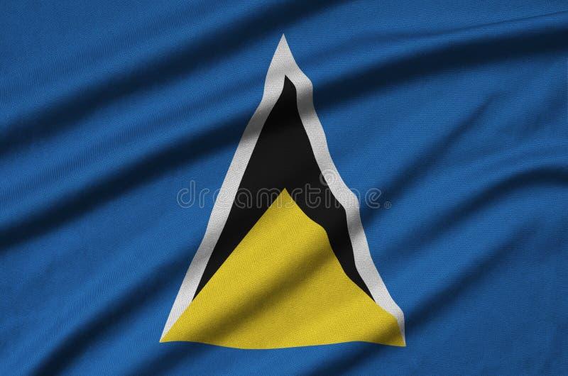 A bandeira de St Lucia é descrita em uma tela de pano dos esportes com muitas dobras Bandeira da equipe de esporte fotografia de stock royalty free